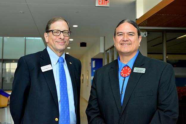 Don Warne (right) and Joshua Wynne, dean of the UND School of Medicine & Health Sciences, stand together as Warne is welcomed as the new director of Indians into Medicine (INMED). Image courtesy of Wanda Weber/School of Medicine & Health Sciences.