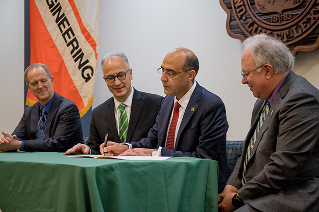 Vice President for Research & Economic Development Grant McGimpsey, UND President Mark Kennedy, UND College of Engineering & Mines Dean Hesham El-Rewini, and Vice President for Finance & Operations Jed Shivers signing the $10 million UND investment
